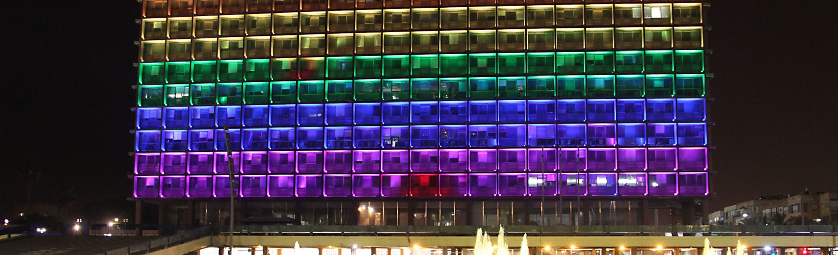 The Tel Aviv Municipality building, at Rabin Square, is lit with the colors of the Pride flag, on June 4, 2014, ahead of the Tel Aviv Gay Pride Week from June 8-14. Photo by Gideon Markowicz/Flash 90. *** Local Caption *** úì àáéá áðééï òéøééä ëéëø øáéï ãâì äâàååä ùáåò äâàååä